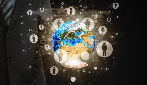 Businessman hold Earth and contacts Stock photo © cherezoff