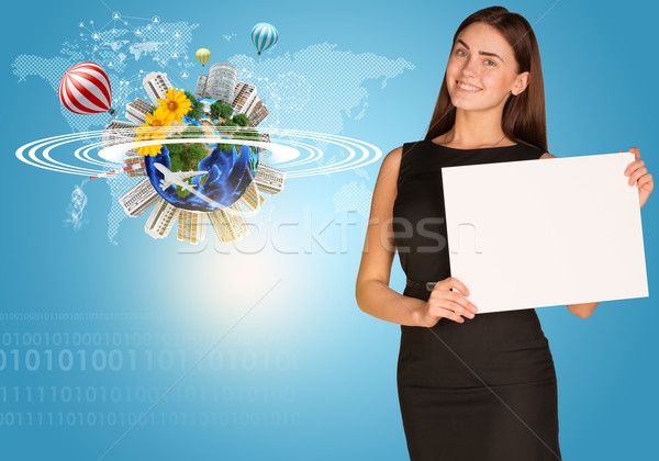 Beautiful businesswoman holding paper holder. Earth with buildings and figures Stock photo © cherezoff
