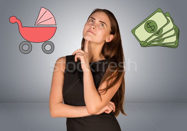 Business woman with money and buggy Stock photo © cherezoff
