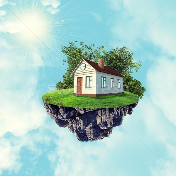 Maison blanche brun toit île ciel nuages Photo stock © cherezoff