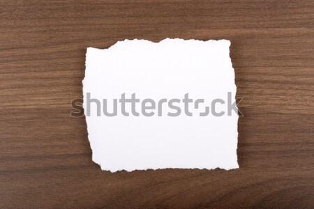 Bianco pezzo carta irregolare rosolare tavolo in legno Foto d'archivio © cherezoff