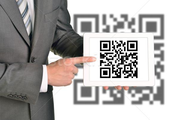 Businessman holding QR-code Stock photo © cherezoff