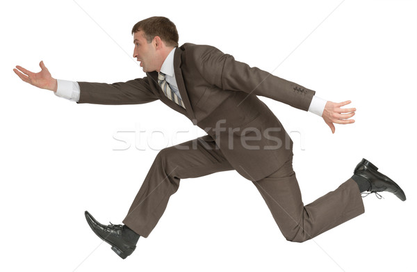 Businessman running fast with empty hand on white Stock photo © cherezoff