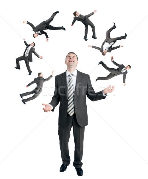 Businessman juggling little people Stock photo © cherezoff