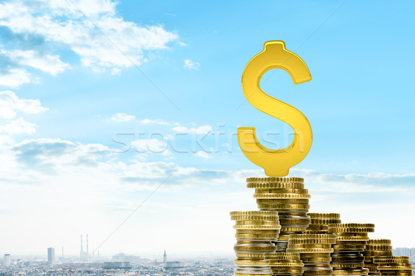Gold dollar sing on pile of coins Stock photo © cherezoff