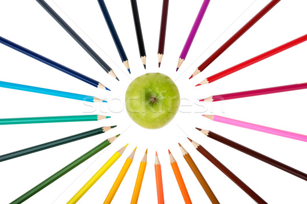 Apple with crayons Stock photo © cherezoff