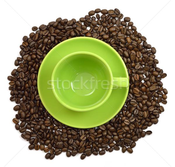 Verde copo pires grãos de café isolado branco Foto stock © cherezoff