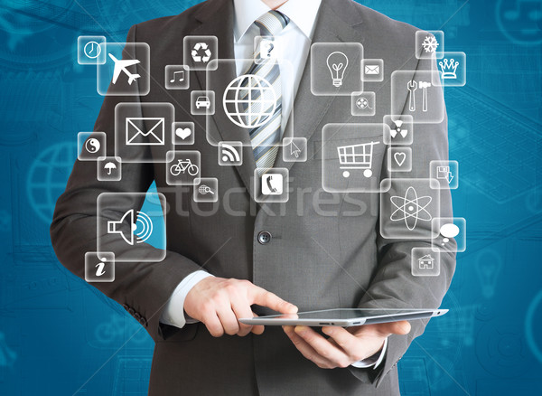 Man in suit holding tablet pc Stock photo © cherezoff