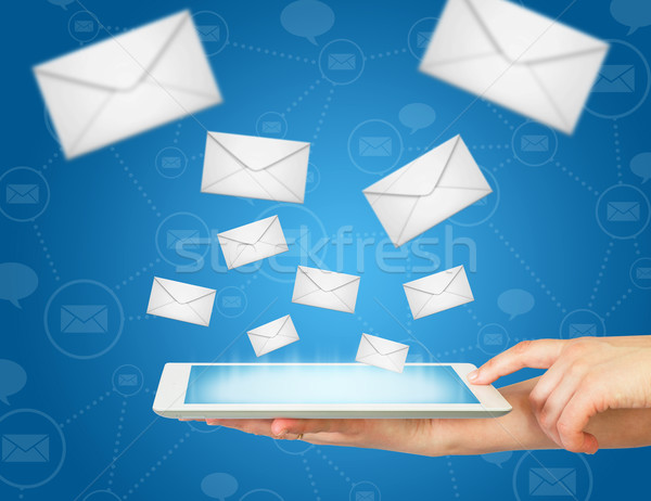 Hand, tablet pc and envelopes Stock photo © cherezoff