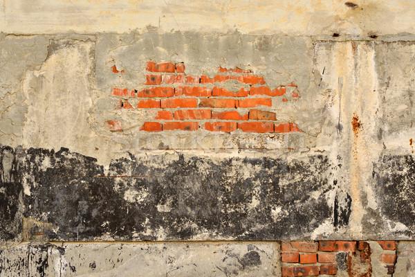 Vecchio screpolato superficie concrete mattoni Foto d'archivio © cherezoff