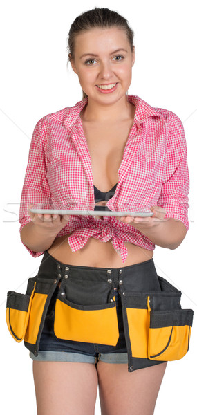 Woman in tool belt holding tablet PC on her palms Stock photo © cherezoff