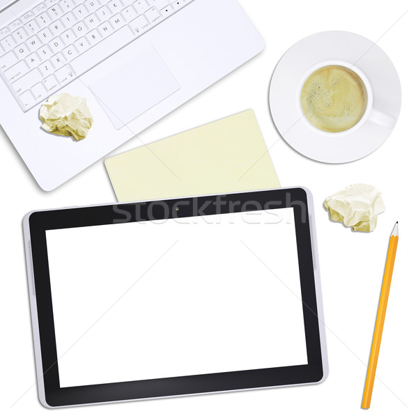 Black tablet with laptop and crumpled paper Stock photo © cherezoff