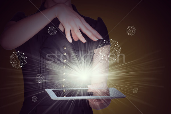 Businesslady with tablet and spotlight Stock photo © cherezoff