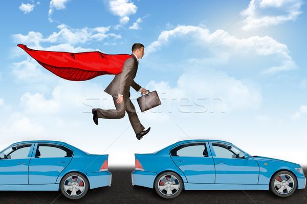 Businessman hopping cars Stock photo © cherezoff