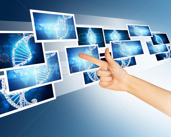 Kéz mutat kék holografikus képek absztrakt Stock fotó © cherezoff
