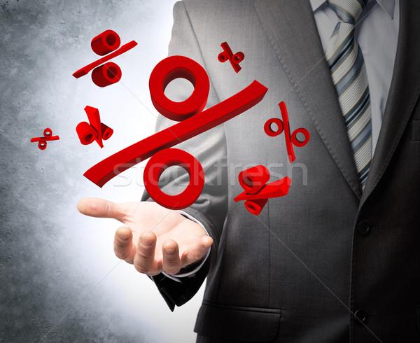 Geschäftsmann halten Prozentsatz Zeichen grau Wand Stock foto © cherezoff