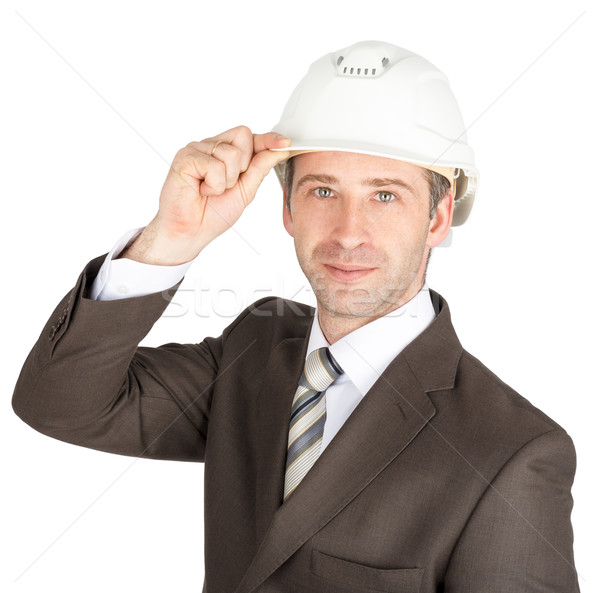 Businessman in suit raised his hard hat to greet Stock photo © cherezoff