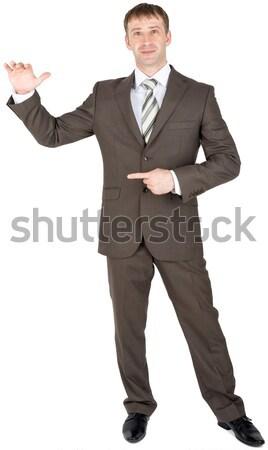 Bright entrepreneur pointing away Stock photo © cherezoff