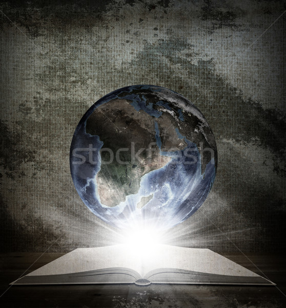 Over an open book is planet earth Stock photo © cherezoff