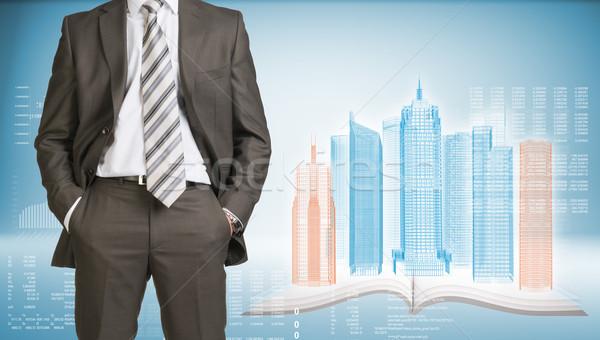 Zakenman wireframe gebouwen Open boek pak permanente Stockfoto © cherezoff