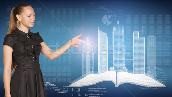 Beautiful businesswoman, open book , spatial layouts of buildings, figures. letters and diagram as b Stock photo © cherezoff