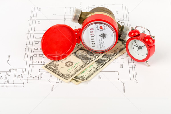 Water meter with money and alarm clock Stock photo © cherezoff
