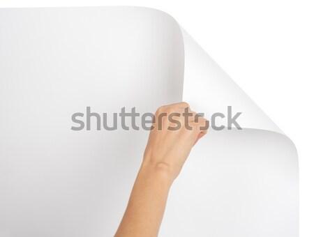 Hand turning upper empty page corner Stock photo © cherezoff