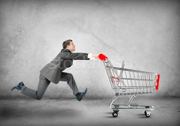 Businessman pushing shopping cart  Stock photo © cherezoff