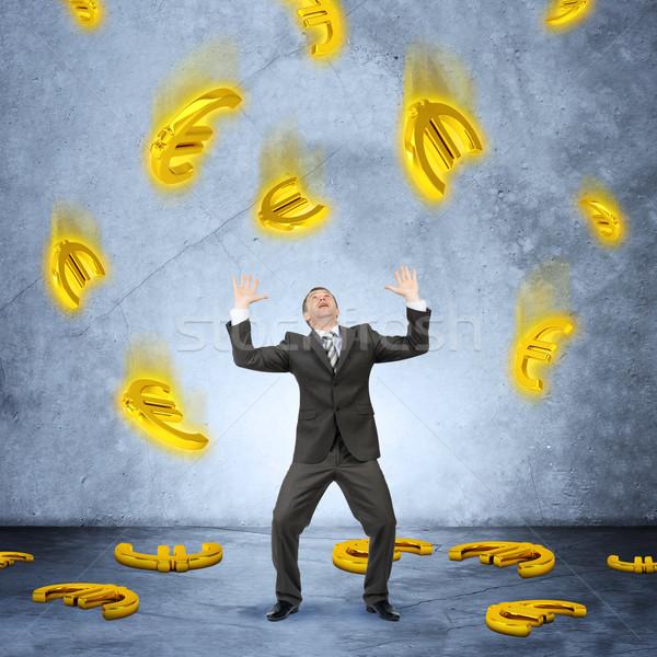 Businessman under money rain Stock photo © cherezoff
