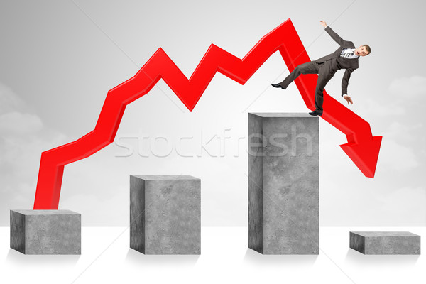 Declining chart, businessman turning into troubles Stock photo © cherezoff