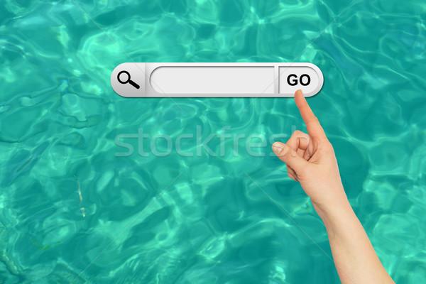 Stockfoto: Menselijke · hand · Zoek · bar · browser · turkoois · wateroppervlak