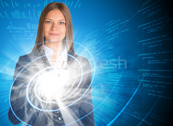 Businesswoman pointing her finger on glowing spiral Stock photo © cherezoff