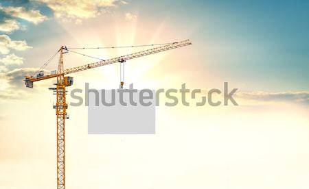 Heating and building cranes over green hills. Blank billboard Stock photo © cherezoff