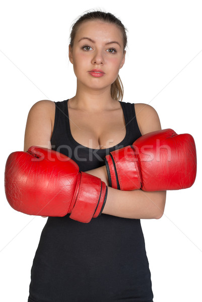 Woman in boxing gloves with her hands crossed on breast Stock photo © cherezoff