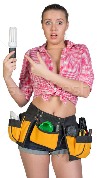 Woman in tool belt holding energy-saving lamp Stock photo © cherezoff