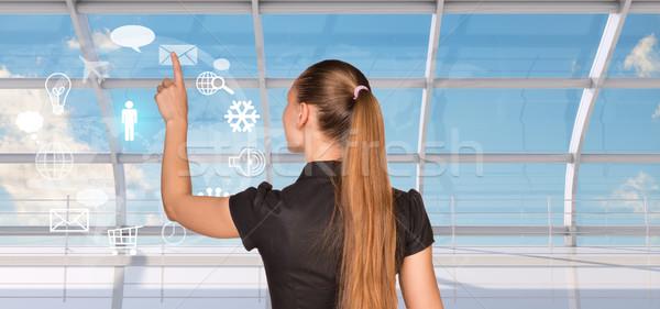 Hátsó nézet nő kisajtolás holografikus képernyő üzletasszony Stock fotó © cherezoff