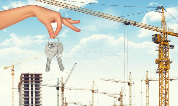 Kéz tart kulcsok építkezés ipari nő Stock fotó © cherezoff