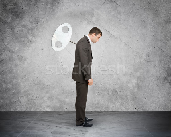 Zakenman sleutel Maakt een reservekopie naar beneden te kijken kantoor gezicht Stockfoto © cherezoff
