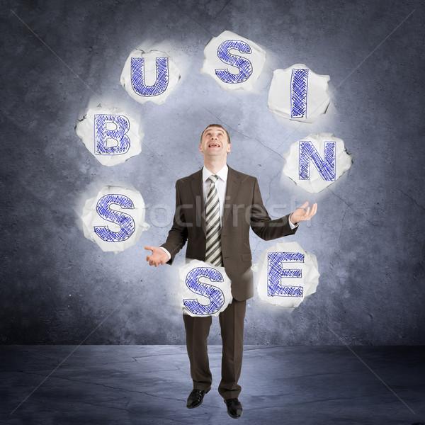 Empresário malabarismo palavra negócio abstrato cinza Foto stock © cherezoff