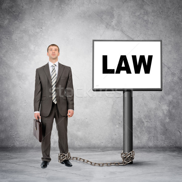 Businessman word law on post sign Stock photo © cherezoff