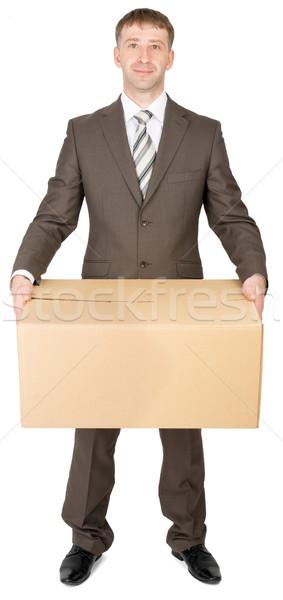 Menedzser öltöny tart csomag doboz izolált Stock fotó © cherezoff
