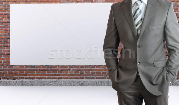 Businessman standing with hands in pockets Stock photo © cherezoff