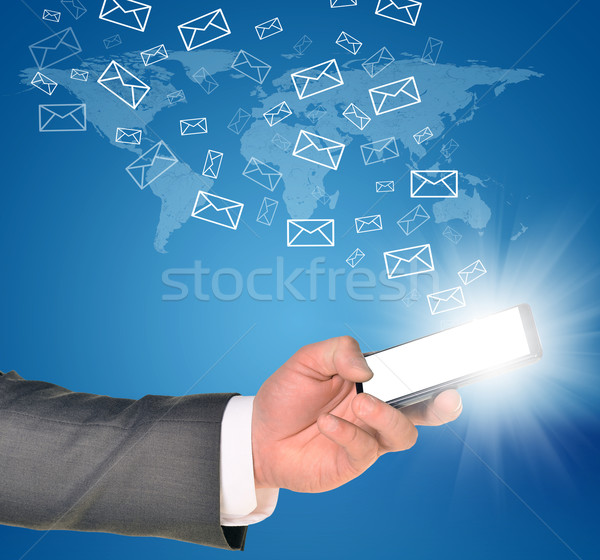 Business man using a mobile phone within left hand Stock photo © cherezoff