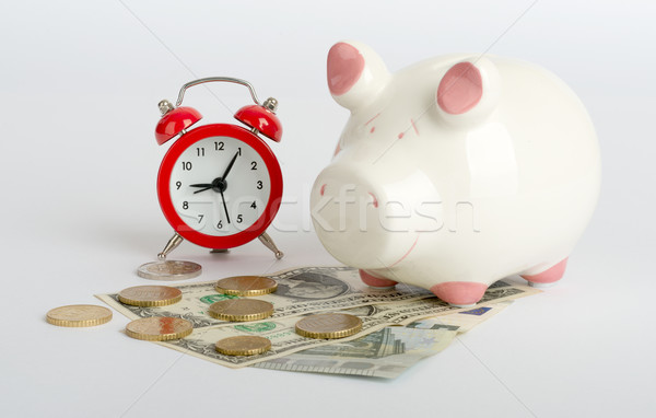 Stock photo: Piggy bank with cash