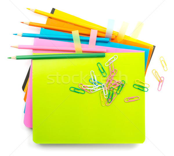 Crayons with clips on copybooks Stock photo © cherezoff