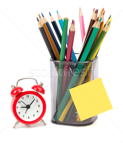 Crayons with alarm clock Stock photo © cherezoff