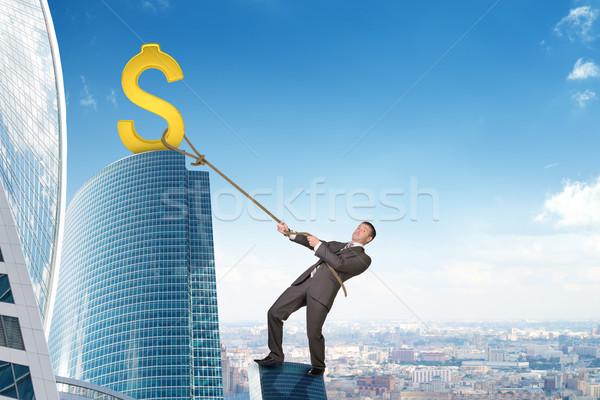 Biznesmen wspinaczki wieżowiec znak dolara złoty Zdjęcia stock © cherezoff