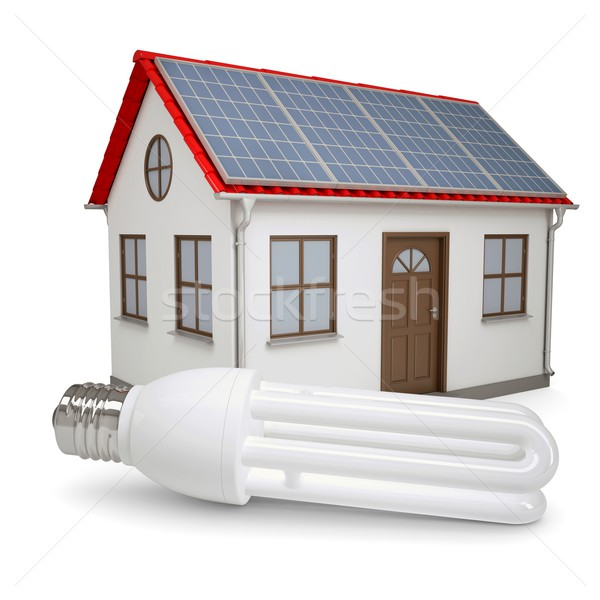 Energy saving lamp on the background of the house with solar panels Stock photo © cherezoff