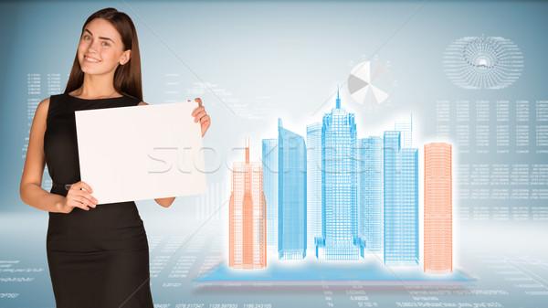 Zakenvrouw houden papier vel wireframe Stockfoto © cherezoff