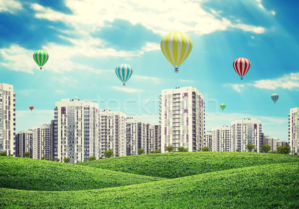 high-rise buildings over green hills, air balloons above Stock photo © cherezoff
